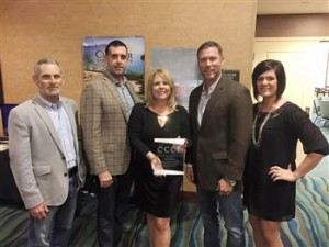 Several members of the Choctaw Chamber of Commerce Board of Directors were in attendance to celebrate Thursday night as Choctaw's Tracy Mosley was honored with the Chamber Executive of the Year Award. Pictured is Mitch Hale, Todd Isaac, Tracy Mosley, Jeff Hogan and Sara Botchlet.