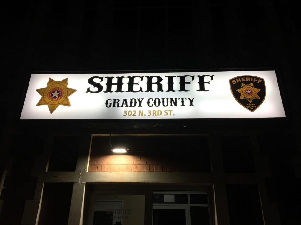 Sheriff's Sign New Office