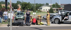 Mustang emergency crews responded to a motorcycle wreck on N. Mustang Road and E. Trade Center Terr. on Thursday, July 7. (Staff photo by Jon Watje)