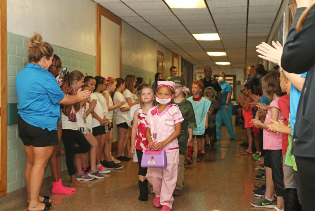 """Children show off their costumes during a """"Hero Parade"""" last Thursday at Rose State's Kids College. The summer program offers a variety of learning opportunities for children in grades K-6. (Staff photo by Jeff Harrison)"""