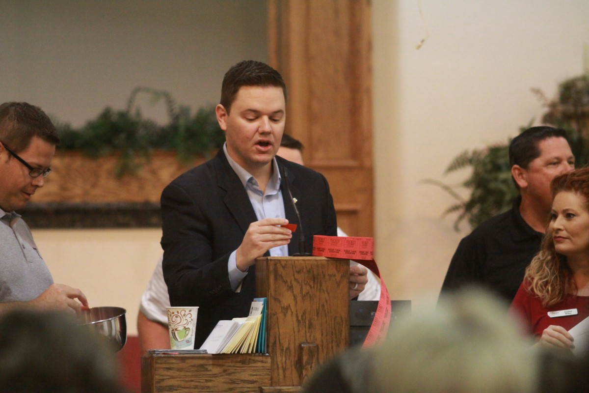 Chamber President and Edward Jones rep Matt Soutee reads a ticket number for a door prize Thursday, Aug. 18 at Snow Hill Baptist Church during the Third Annual Teacher Appreciation Breakfast.
