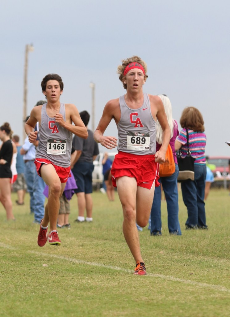 Carl Albert's Camden Shaw (left) and Coal Phillips (right) finished in the top five last Friday during the Carl Albert Titan Cross Country Invitational. (Staff photo by Jeff Harrison)