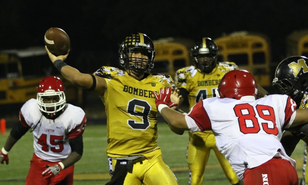 Midwest City's Preston Colbert makes a throw Friday night during a 20-17 win over Lawton.