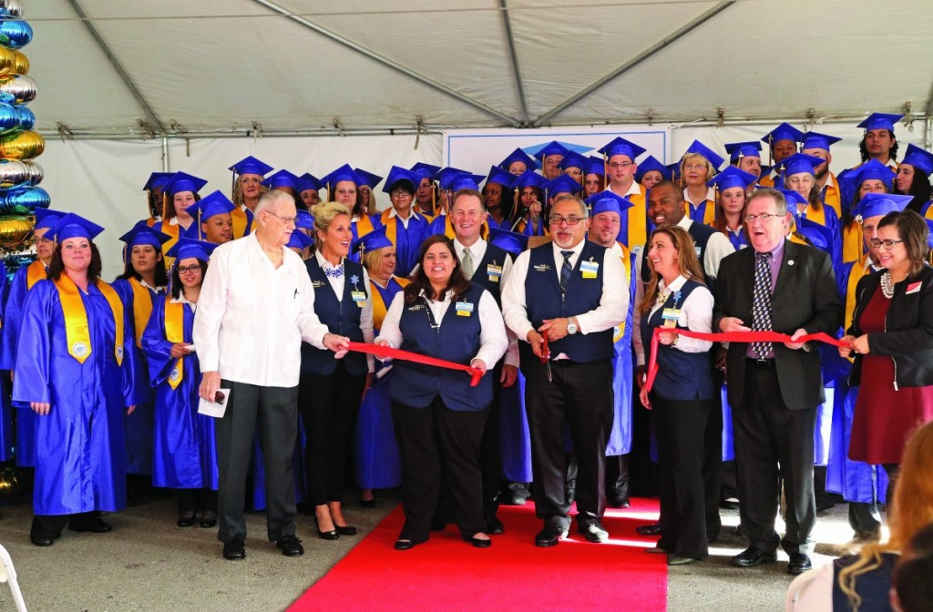Walmart officials and Del City officials cut a ceremonial ribbon Tuesday opening the new training academy at the Walmart Supercenter in Del City. The training academy is one of two in Oklahoma. (Staff photo by Jeff Harrison)