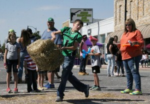 The annual hay bale throw is a contest that always draws a large crowd on Main Street during Jones Old Timers Day. (Photo by Ryan Horton)