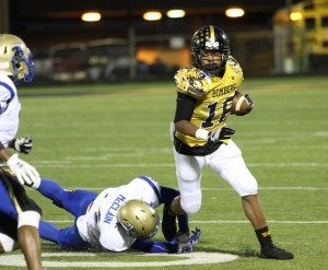 Midwest City's Kyle Lindsay runs past a Choctaw defender Friday night during a District 6A-II-1 game at Rose Field. (Staff photo by Jeff Harrison)