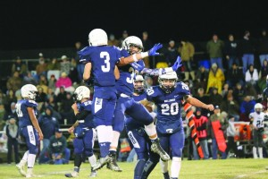 The Minco Bulldogs celebrate a play in their game against Cordell on Friday. Minco won the game, 62-12