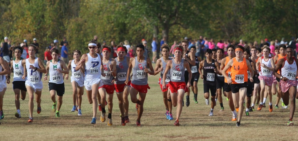 The Carl Albert High School boys cross country team takes off from the staring line Saturday morning during the Class 5A state meet at Edmond Santa Fe High School. Coal Phillips won the race and Camden Shaw finished seventh overall. The Titans placed third as a team. (Staff photo by Jeff Harrison)