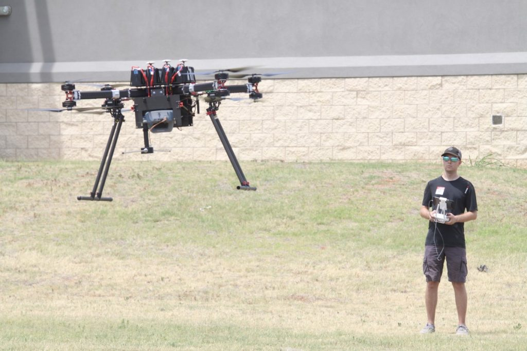 A member of Oklahoma State University's Unmanned Systems Research Institute pilots a drone for an FAA feasibility test.