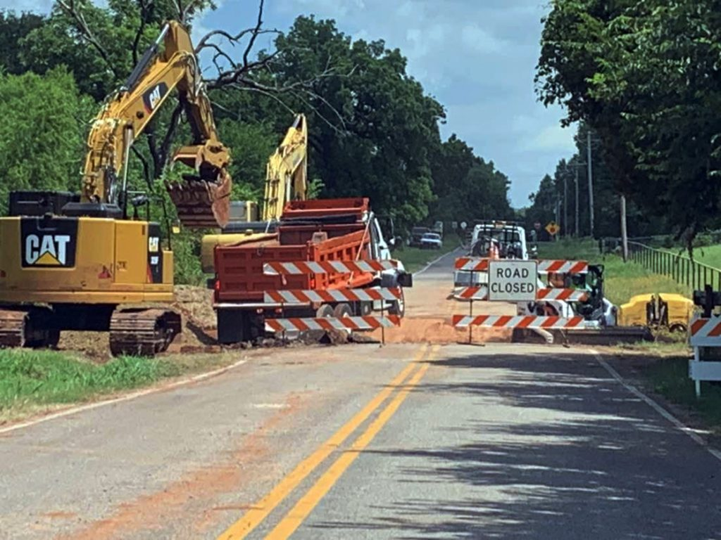 Oklahoma City was also charged with a more recent flood-related reconstruction – a sinkhole on South Czech Hall Road, just south of SW 104th Street. Work continues on that project, which does not yet have a firm completion date. (Staff photo by Traci Chapman)