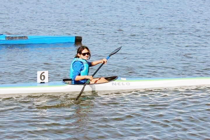 Shelby Pradella, of Mustang,  competes in a kayak sprint race. (Provided photo)