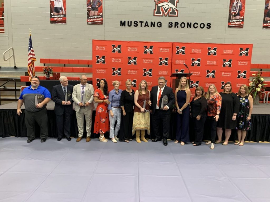 The Mustang High School Sports Hall of Fame inducted five new members Saturday evening during a ceremony at the Mustang Events Center. The 2019 class included football coach Charles Carpenter, multi-sport star Toby Daugherty, Olympic weightlifter Shane Hamman, three-sport star James Garner, and the undefeated 1984 state champion volleyball team. (Provided photo)