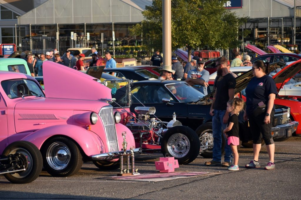 Mustang Lions partnered with Thursday Night Cruisers for a weekend event at Mustang Lowe's. Featuring Lions' mobile health screening unit, 87 classic cars, food, music and fun, the event drew hundreds of people. (Staff photo by Traci Chapman)