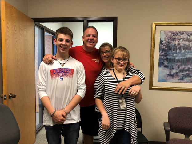 Joel Bain, a Midwest City firefighter, reunited with Chloe Marquardt who he delivered during an emergency 16 years ago.  Pictured from left,Joel's son Conner, Joel, Laura Martin and Chloe Marquardt. (Photo by Aaliyah Herrera)