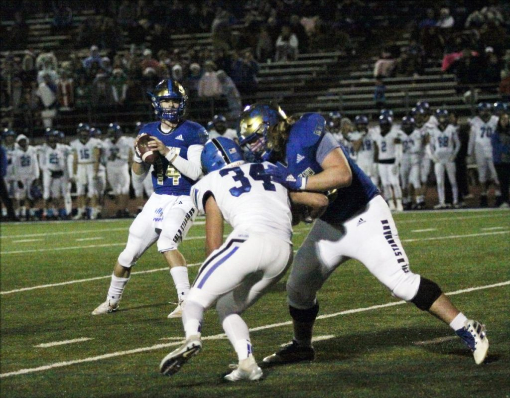 Choctaw's O-Line give senior QB plenty of time against Deer Creek. (Photo by Ryan Horton)