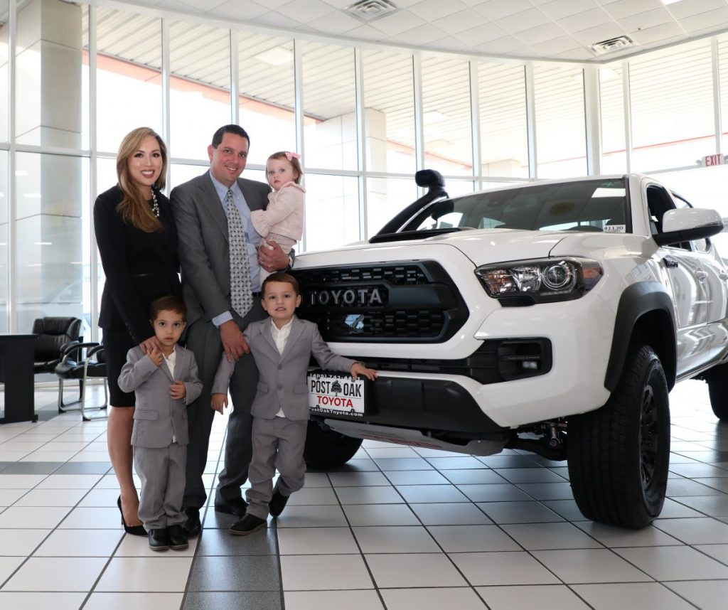 Richard Jones and his family at  Post Oak Toyota, formerly Hudiburg Toyota in Midwest City. Jones is part of an ownership group that bought the business from Hudiburg Auto Group and will serve as president. (Photo by Jeff Harrison)