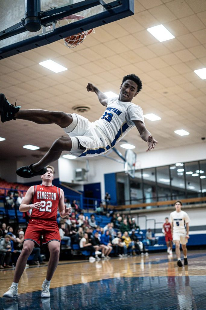 After putting in a dunk on Kingston, Choctaw's Terrill Davis looks towards his landing. CHS beat Kingston, 91-52. (Photo by Jason Turner)