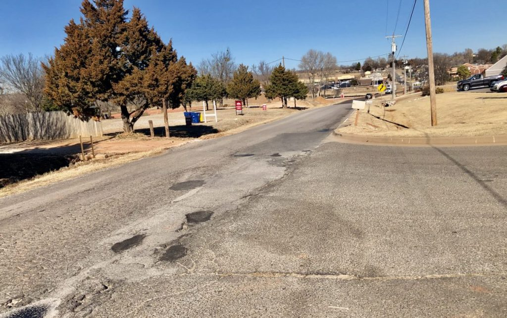 Failed road repairs are common near Harper and NE 20th. City officials say the roadway is one of many that needs totally rebuilt beginning with a proper base. (Photo by Ryan Horton)