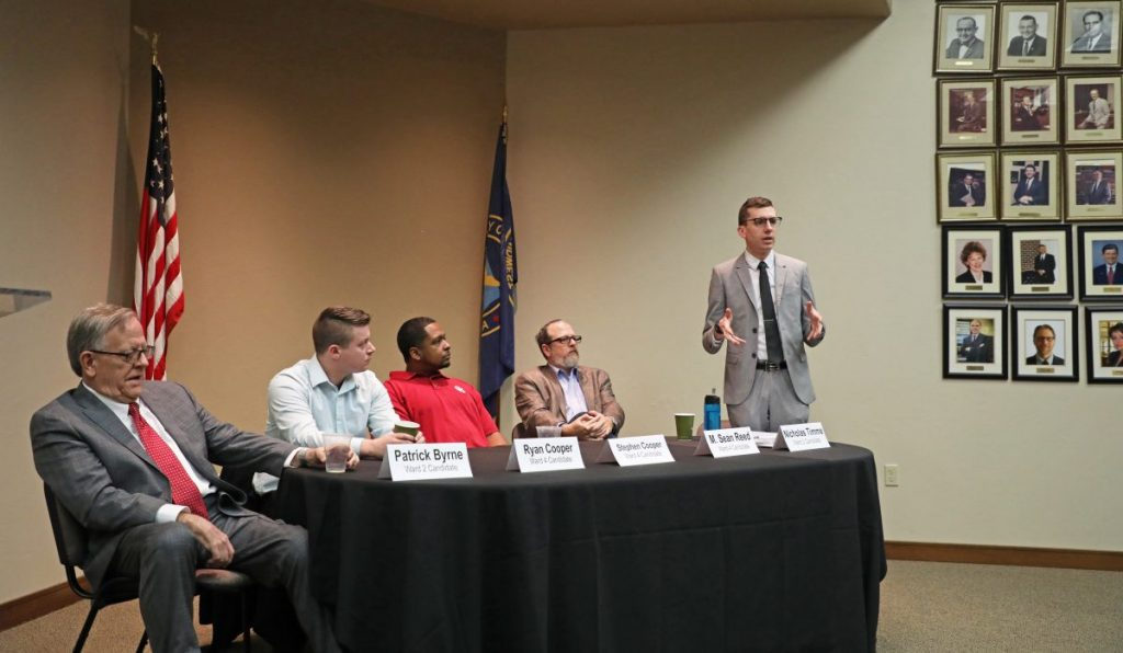 Nicholas Timme speaks during a candidate forum last Tuesday morning at the Midwest City Chamber of Commerce office. Other candidates that attended the event, from left, Ward 2 Councilman Pat Byrne, Ryan Cooper, Ward 4 candidate, Stephen Cooper, Ward 4 candidate, Ward 4 Councilman Sean Reed, and Timme, Ward 2 candidate. (Photo by Jeff Harrison)