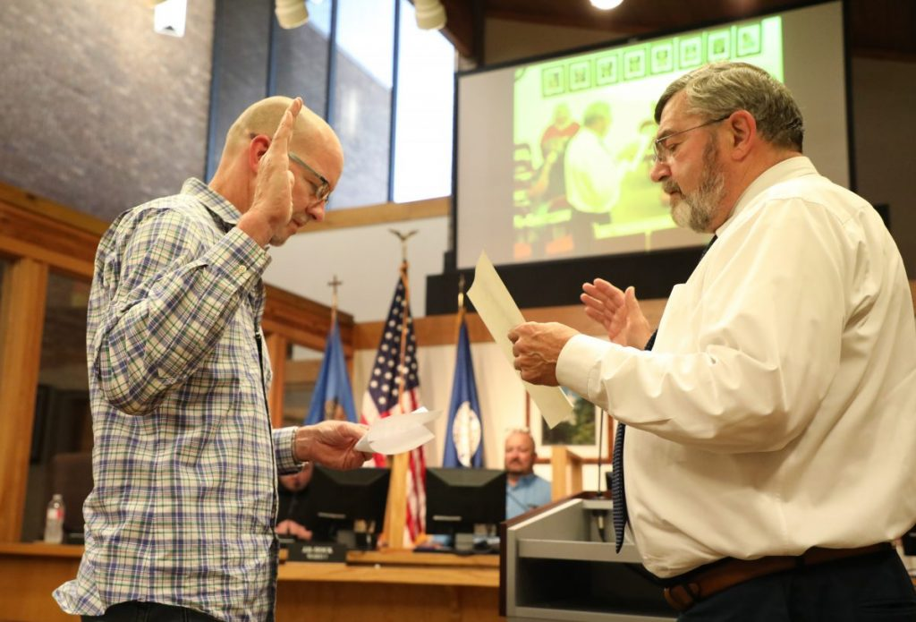 Michael Butler (Left) is sworn in as a member of the Del City Council by Mayor Floyd Eason (Right).  (Photo by Jeff Harrison)