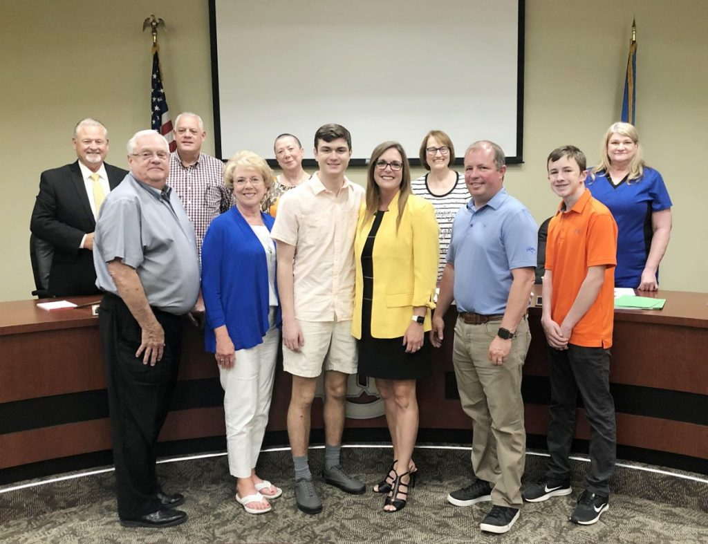 Debbie Worley celebrates with family and the Choctaw-Nicoma Park School Board after being named the director of the new CNP Virtual School.