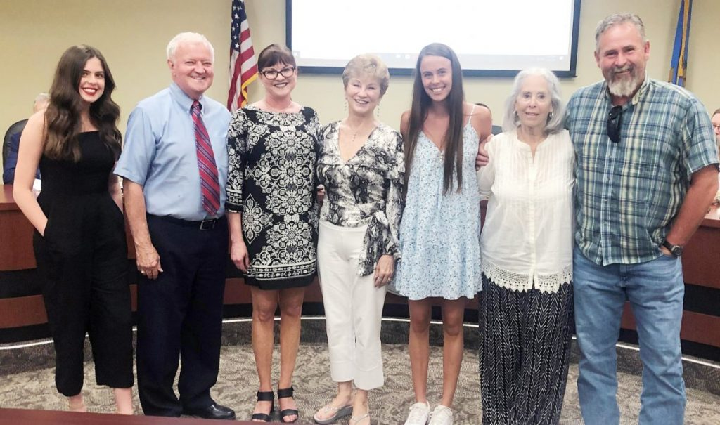 Jackie Harris celebrates with her family at the June 8 board meeting.