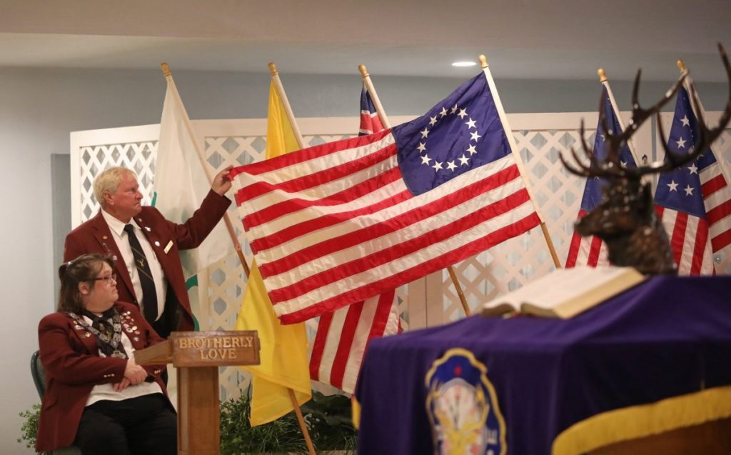 Stan Mills displays the Betsy Ross Flag Sunday during a Flag Day ceremony at the Midwest City Elks Lodge. The organization had to scale back their annual event this year due to COVID-19.  (Photo by Jeff Harrison)