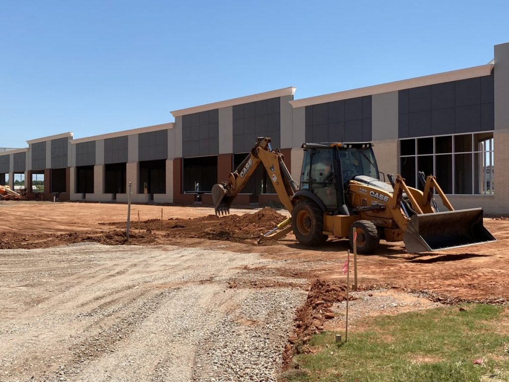 Construction continues on the Mustang Plaza Shopping Center near Sara Rd. and State Highway 152. Sports Clips, Great Clips and Tropical Smoothie Cafe plan to open there. (Photo by Steve Coulter)