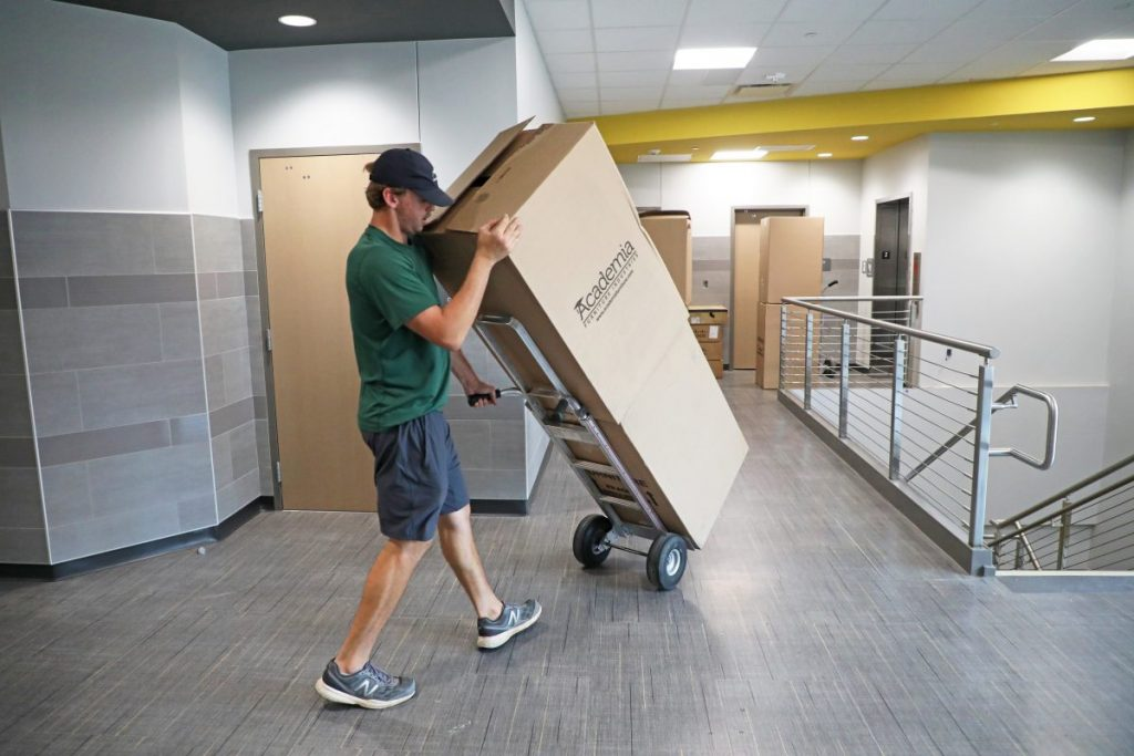 Movers bring new furniture to Midwest City Middle School. (Staff photo by Jeff Harrison)