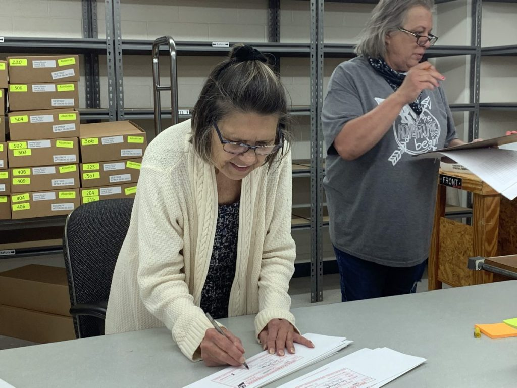 Wanda Arnold, Canadian County Election Board Clerk, counts ballots after the June 30 statewide primary election. (Photo by Traci Chapman)