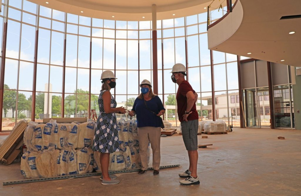 Rose State College employees Tamara Pratt, Anita Poole-Endsley and Jim Vidmar tour the new student union on June 30. (Photo by Jeff Harrison)