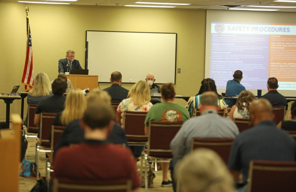 The Mid-Del School Board discuses the district's plan to return to school next month. The district plan includes options for traditional in-person or virtual learning. (Staff photo by Jeff Harrison)