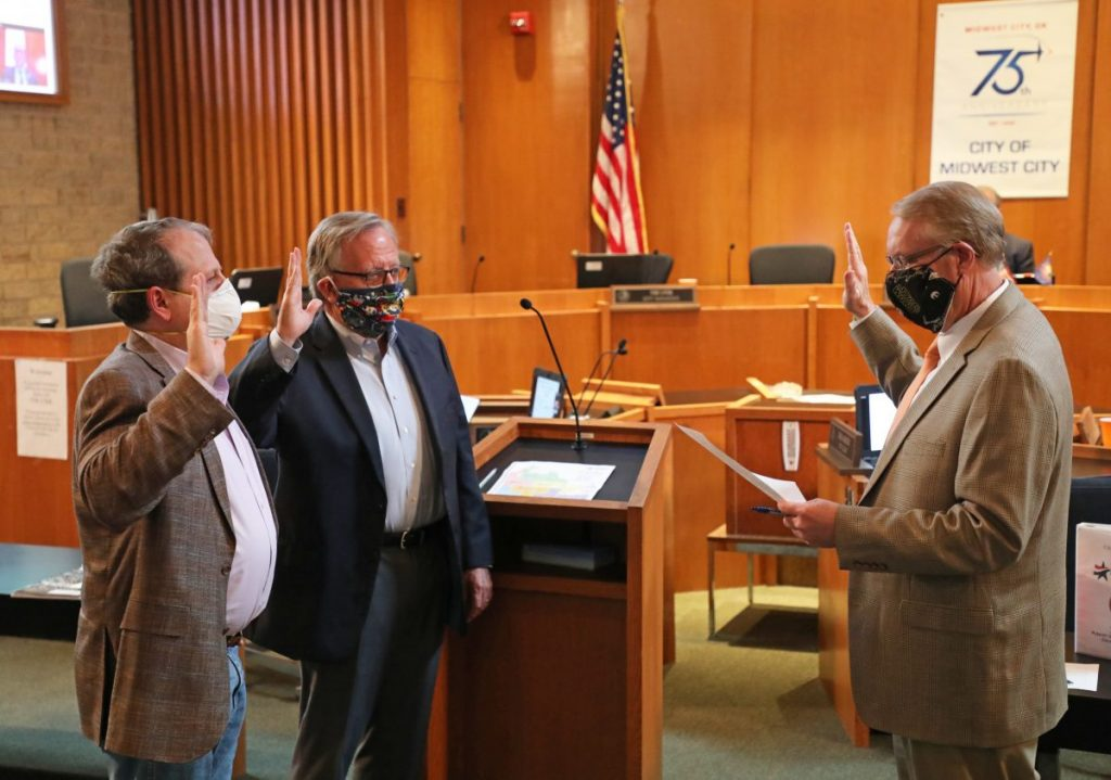 City Manager Tim Lyon and council members Sean Reed and Pat Byrne wear face masks during a meeting in April. The council is considering an ordinance that would require people to wear masks in public. (Staff photo by Jeff Harrison)