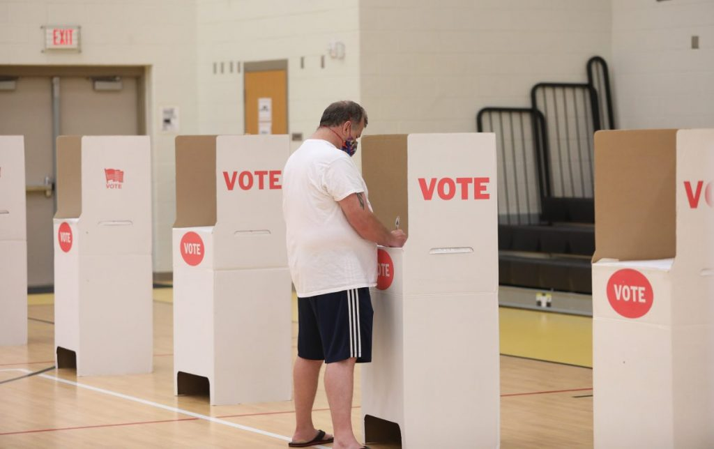 A man votes at Midwest City Elementary School on June 30. (Staff photo by Jeff Harrison)