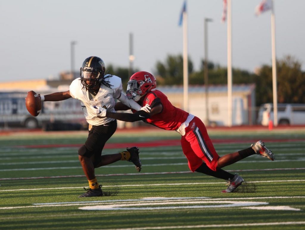 Brian Wilson (Left) tries to escape a tackle by Cobe Crews (Right). (Photo by Jeff Harrison)