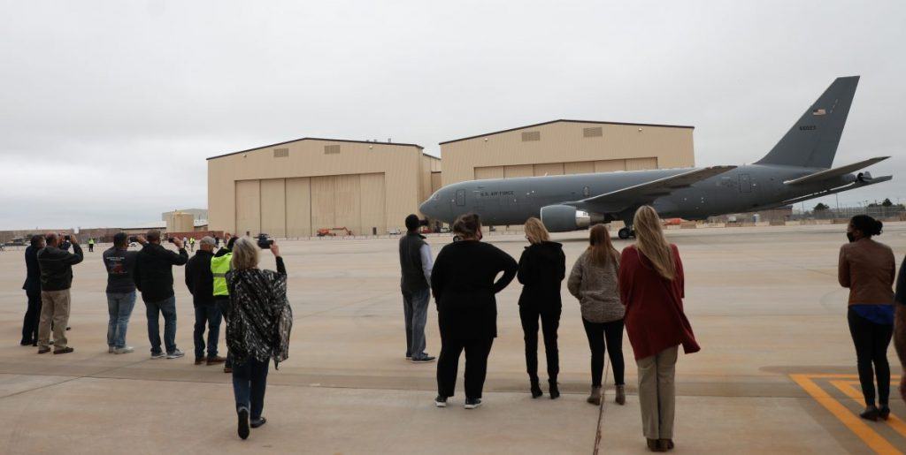 Employees watch as the KC-46A aircraft arrives at Tinker Air Force Base. (Photo by Jeff Harrison)