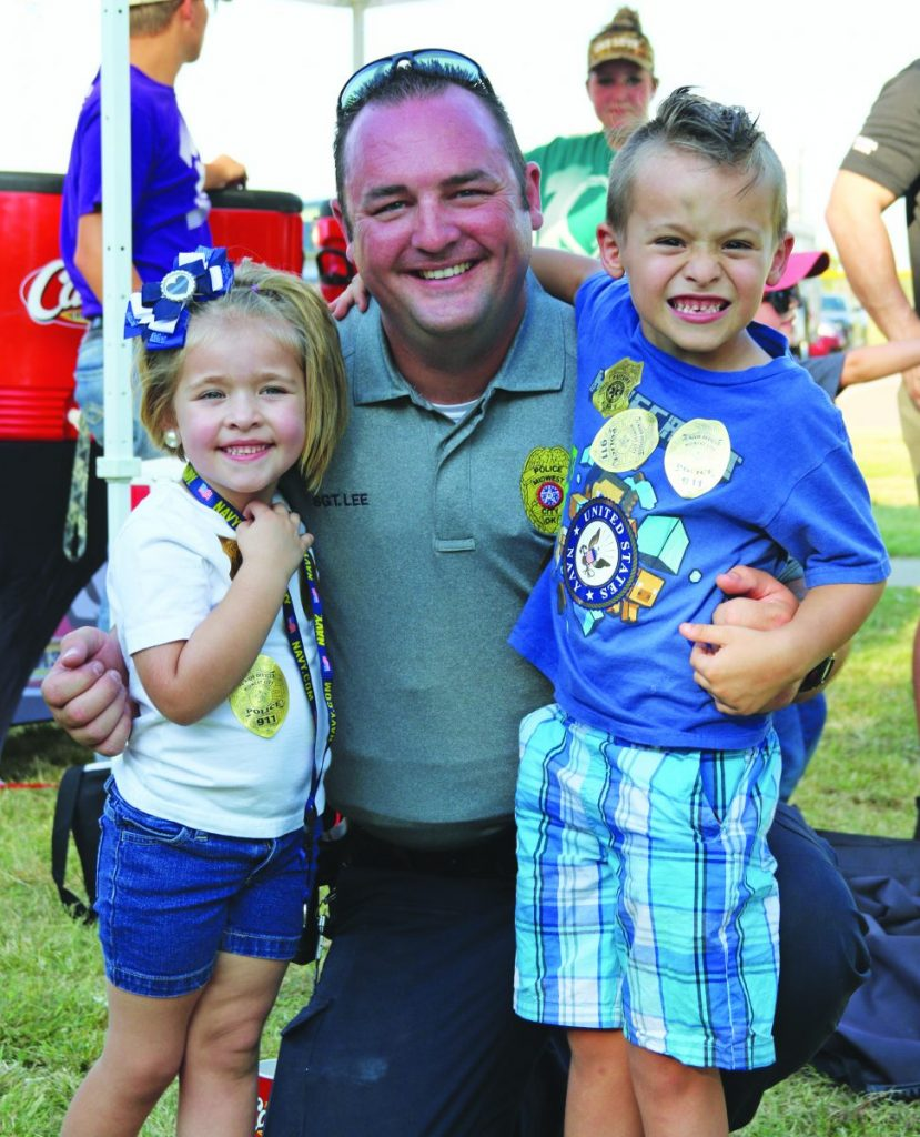 A couple of children take a photo with Sgt. Anthony Lee during a past Picnic with Protectors.  The annual event will take place Thursday at the Rotary Pavilion at Joe B. Barnes Regional Park. (File photo)