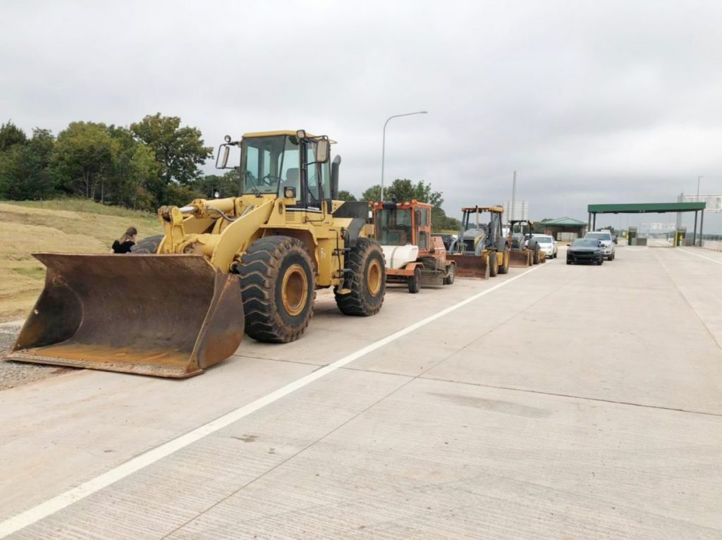 Heavy equipment parks roadside as work is wrapped up near the new toll plaza north of Britton Road Road on the Kickapoo Turnpike. (PHOTO BY RYAN HORTON)