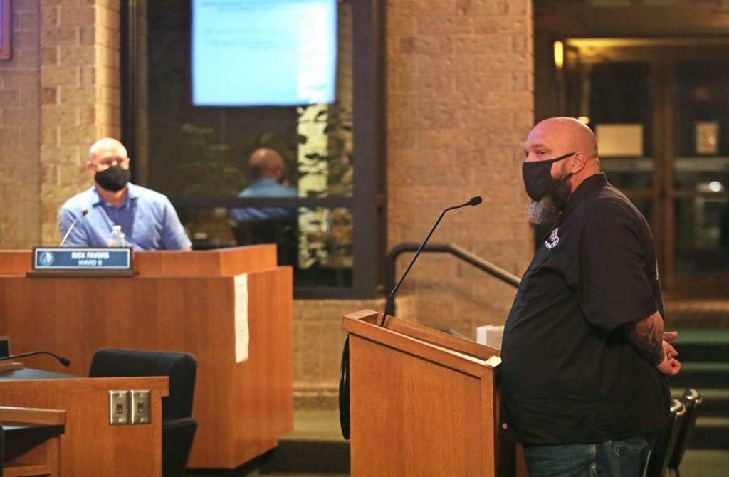 Adam Ely, owner of Hard Luck Automotive Services, speaks about his non-profit organization that provides low cost auto repairs during a city council meeting on Sept. 22. (Photo by Jeff Harrison)