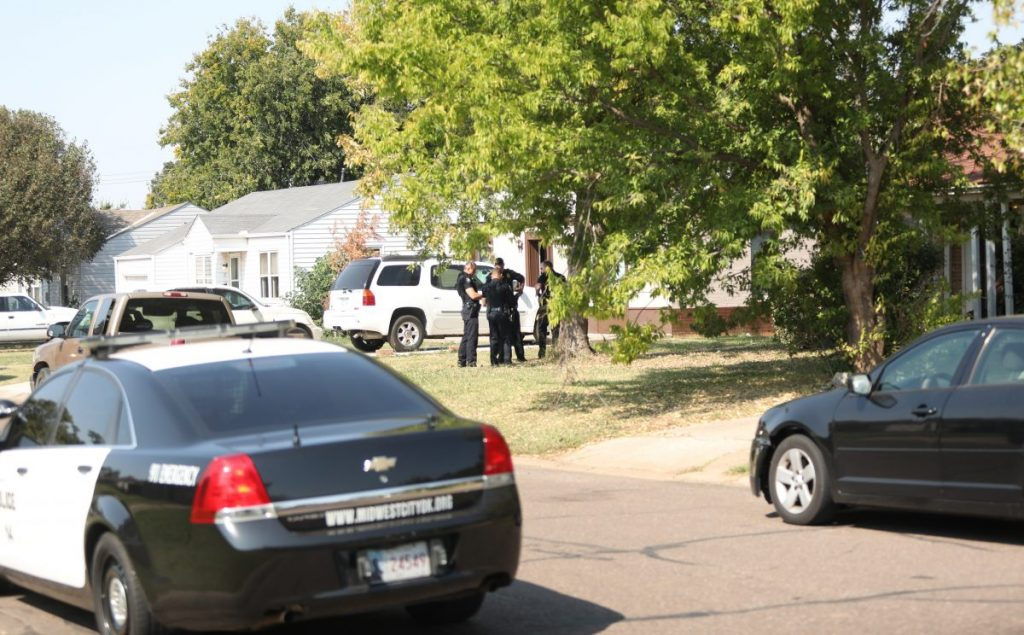 Police investigate a shooting in the 300 block of Douglas Dr. on Oct. 8. (Photo by Jeff Harrison)