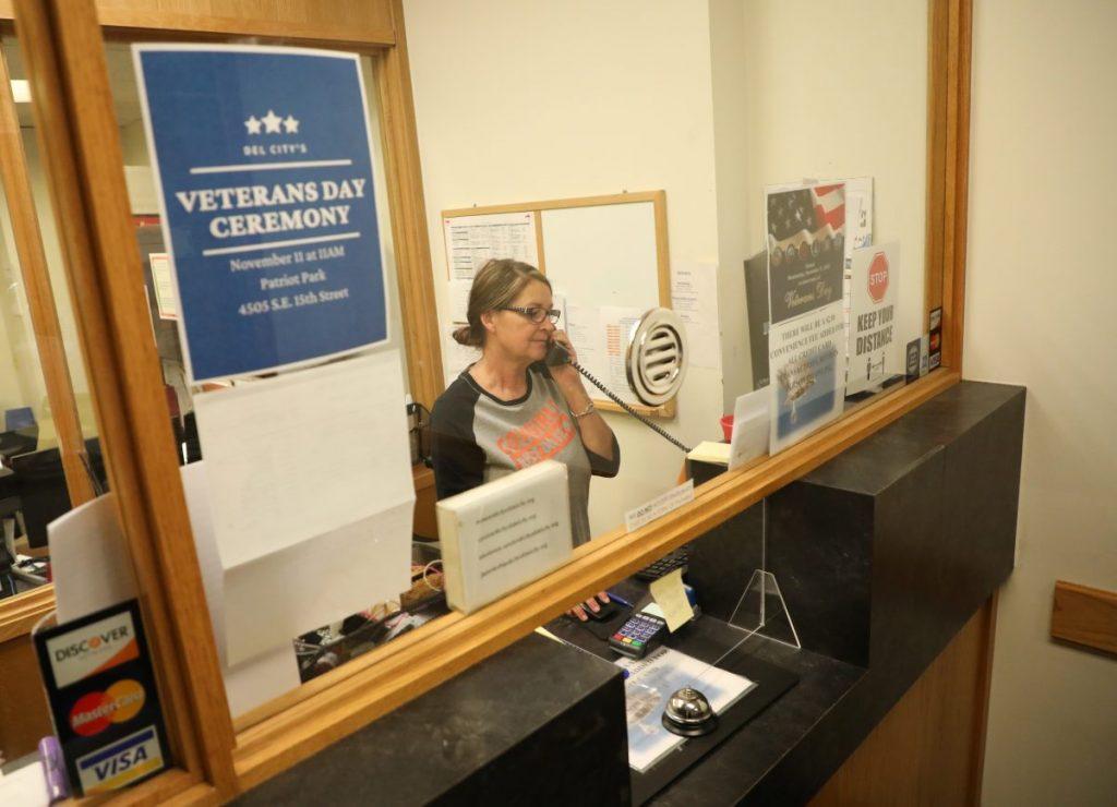 Melinda Lloyd, deputy city clerk, answers a call at Del City's City Hall on Nov. 5. (PHOTO BY JEFF HARRISON )