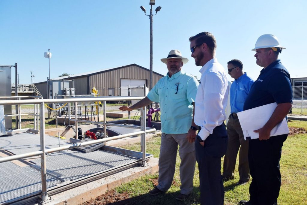 Officials gather for a September 2019 official reopening of the city's wastewater treatment plant, newly named at that time Mustang Water Reclamation Facility – recently named the winner of a Keep Oklahoma Beautiful environmental excellence award. (File photo)