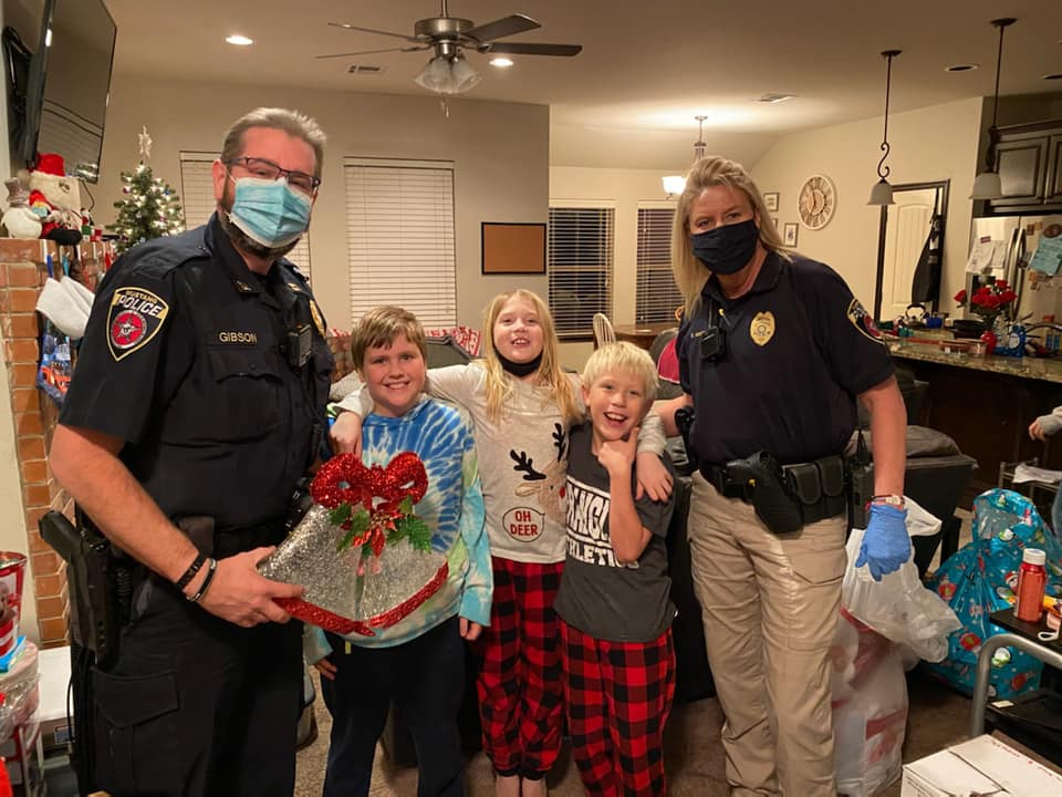 Mustang police captains John Gibson and Camie McNeil made the last of this year's Shop with an Officer deliveries Dec. 12. The program was modified in response to safety issues posed by COVID-19. (Photo courtesy)