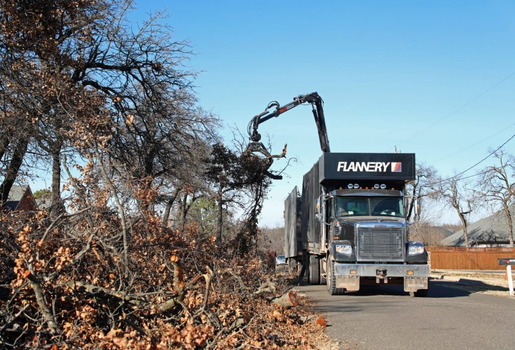 Crews collect branches and debris along Caldwell Drive last week. Midwest City officials say the cleanup from the late October ice storms is about 75% complete. They expect the cleanup to be completed by early February. PHOTO BY JEFF HARRISON