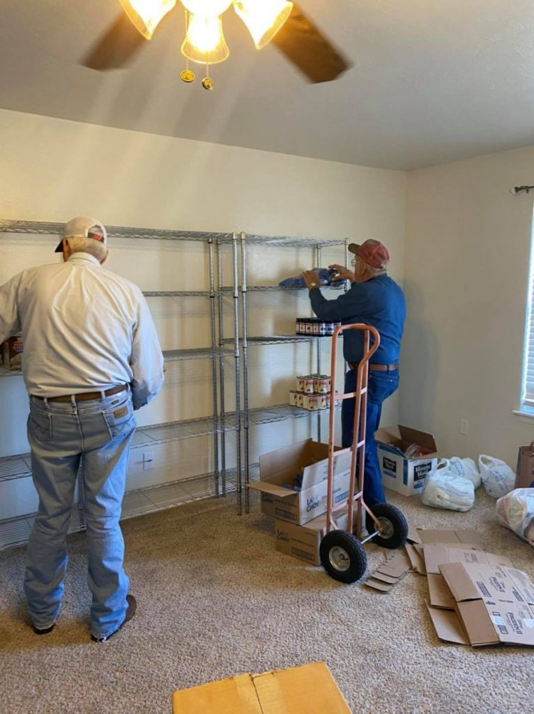 A member of the Union City Methodist Church helps set up the new food pantry that the church makes available to those in need.