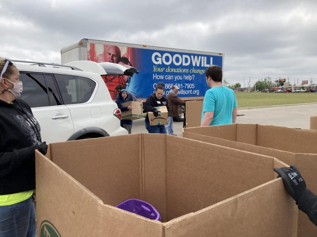 Tuttle Special Olympics volunteers load donations boxes full of donated goods Saturday, April 24.