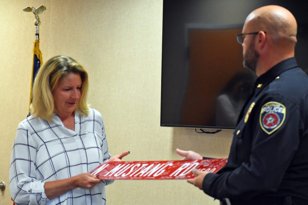 Lt. Camie McNeil was honored June 3 during a retirement ceremony marking her departure from Mustang Police Department after 26 years of service. (Photo by Traci Chapman)