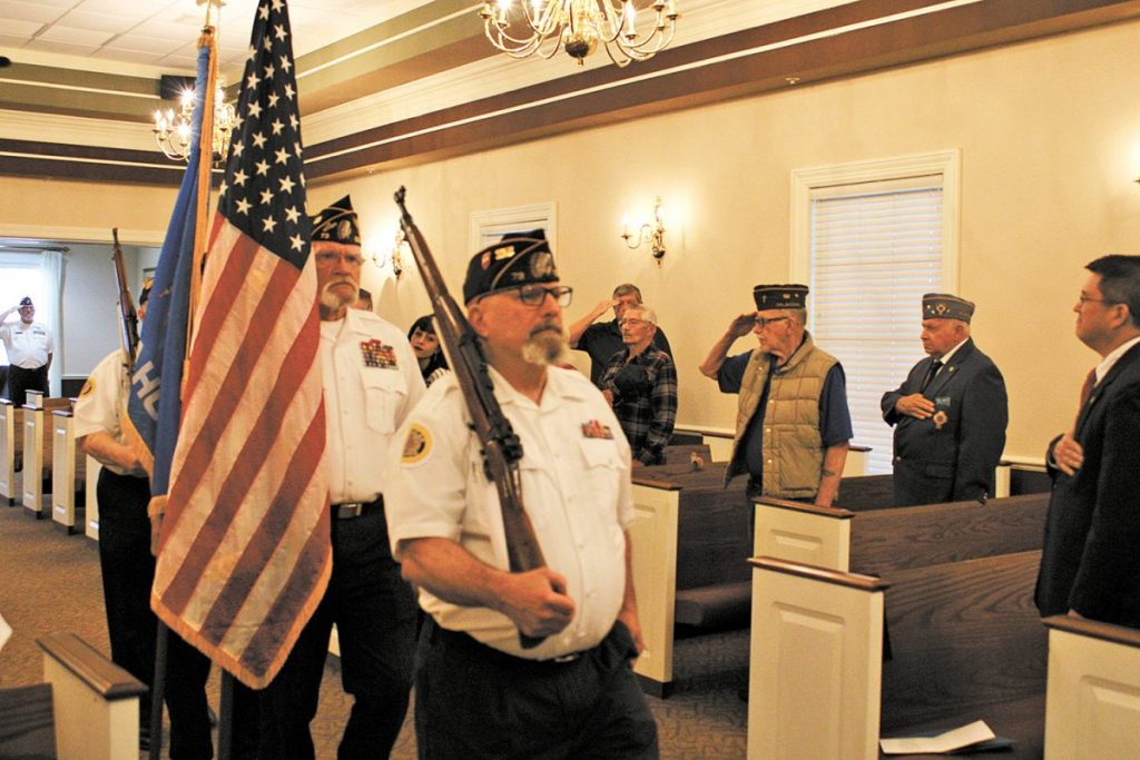 The Del City American Legion and VFW color guard present the colors during Monday's Memorial Day service at Sunnylane Cemetery in Del City. (Photo by Anthony Thomas)