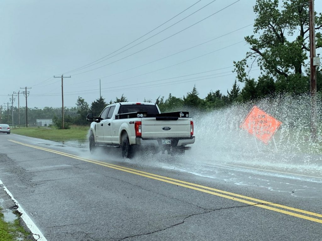 A sign warns drivers of rough conditions on Sara Road in Mustang during a Monday rainstorm. City officials announced late last week they would undergo a temporary overlay project for the roadway expected to be performed June 9-10, after Oklahoma Turnpike Authority pushed backed a long-anticipated expansion of the thoroughfare. (Photo by Traci Chapman)