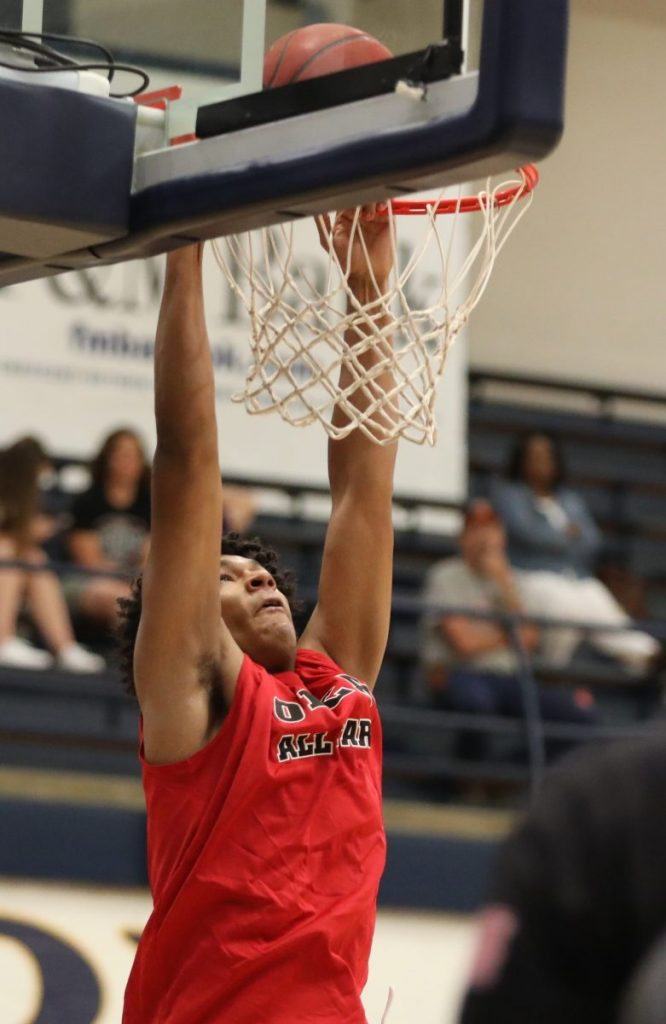 Carl Albert's Quentin Woodson dunks during the OBCA Large School All-State game last Saturday at UCO. (Photo by Jeff Harrison)